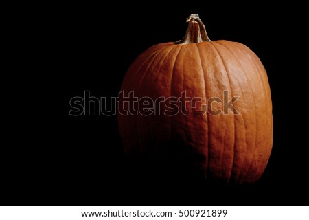 pumpkin on black background Halloween concept