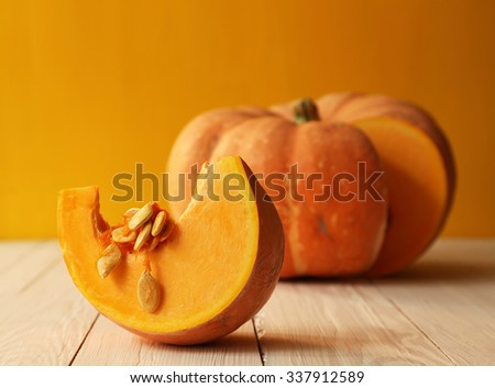 Pumpkin on yellow background - stock photo