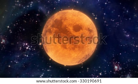 pumpkin orange color of the Halloween moon - Elements of this Image Furnished by NASA  - stock photo