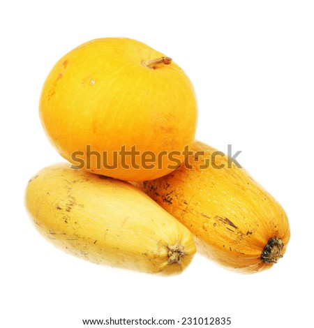 Pumpkin over two zucchini isolated on a white background - stock photo