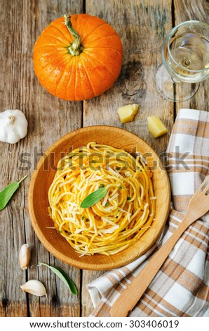 pumpkin pasta with Parmesan cheese and sage. the toning. selective focus - stock photo