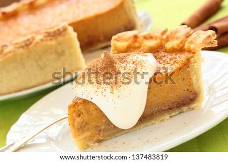 Pumpkin pie, cheese cake with cinnamon. - stock photo