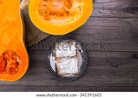 Pumpkin pie on a wooden table - stock photo