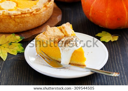 Pumpkin Pie on Thanksgiving Day feast. - stock photo