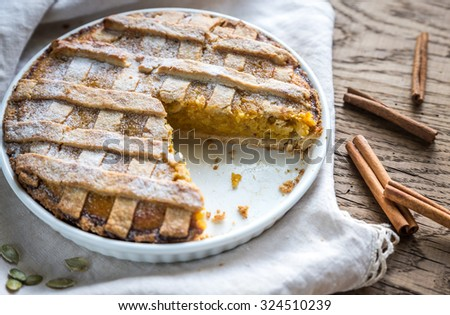 Pumpkin pie on the wooden background - stock photo