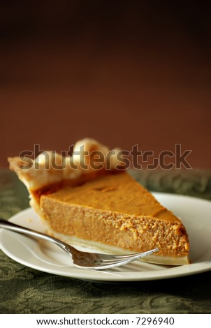 pumpkin pie with autumn green and brown background - stock photo