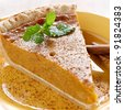 pumpkin pie with mint garnish. - stock photo