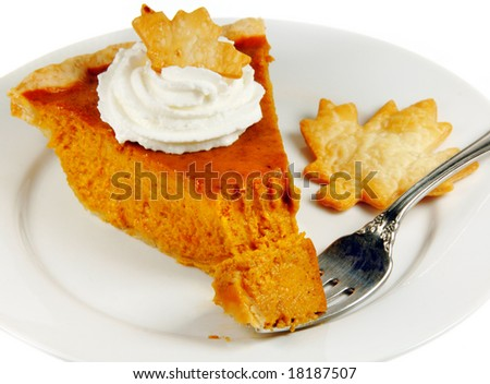 Pumpkin pie with whipped cream on a white plate with a fork. - stock photo