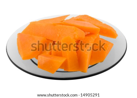 Pumpkin pieces on the plate isolated on white - stock photo