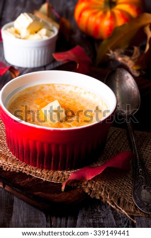 Pumpkin porridge with millet in the clay pot