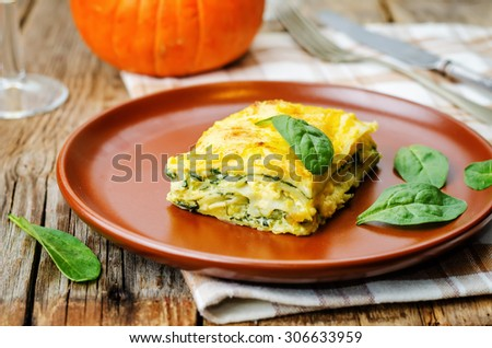 pumpkin ricotta spinach lasagna on a dark wood background. the toning. selective focus - stock photo