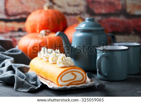Pumpkin roll cake with cream cheese, selective focus - stock photo