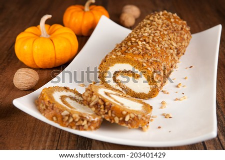 Pumpkin roll with walnuts - stock photo