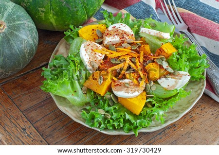 Pumpkin Salad with Fresh Mozzarella and seeds - stock photo