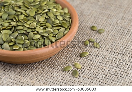 Pumpkin Seeds In A Terracotta Dish - stock photo