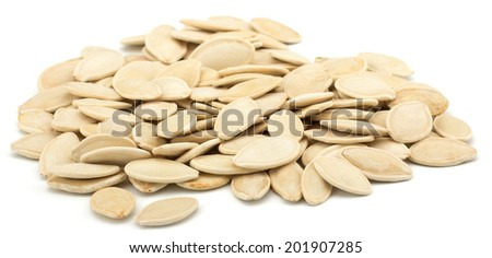 Pumpkin seeds isolated on white background - stock photo