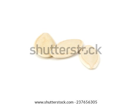 Pumpkin seeds isolated on white background close-up - stock photo