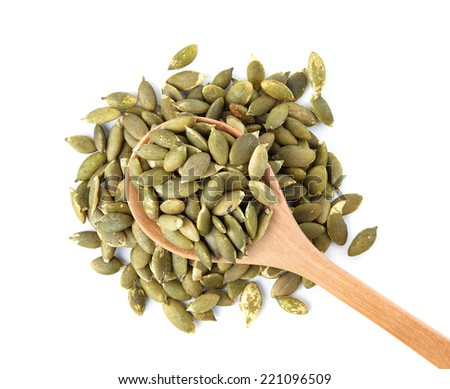 Pumpkin seeds on a white background - stock photo