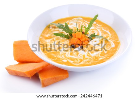 Pumpkin soup and fresh pumpkin slices isolated on white - stock photo