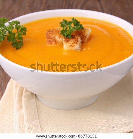 pumpkin soup,crouton and parsley - stock photo