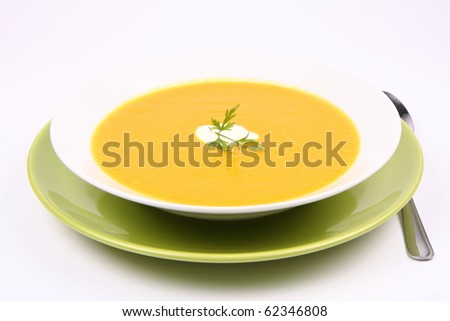 Pumpkin Soup decorated with cream and parsley - stock photo