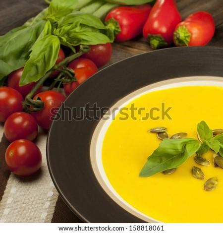 Pumpkin soup from carrots, potatoes and  pumpkin  - stock photo