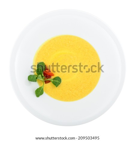 Pumpkin soup isolated on white background. Clipping path - stock photo