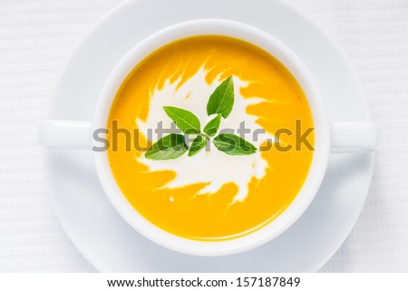 Pumpkin soup on served table. Top view - stock photo