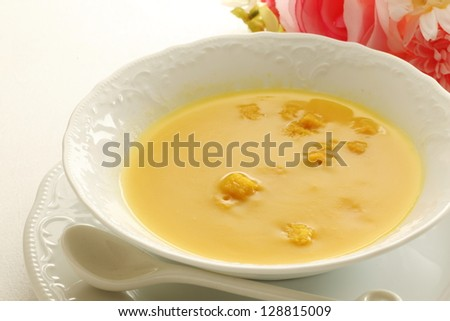Pumpkin soup on white background with copy space