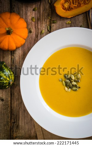 Pumpkin soup on wooden background