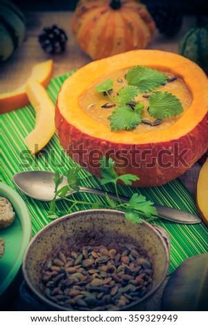 Pumpkin soup served in a hollow fruit vintage