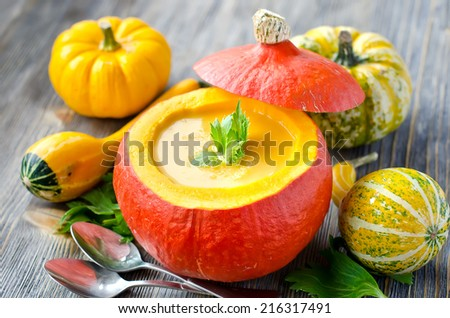 Pumpkin soup with different pumpkins wooden background selective focus