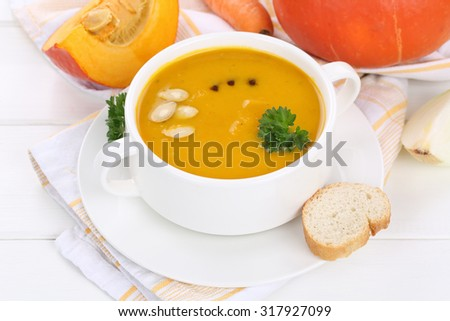Pumpkin soup with fresh pumpkins in cup