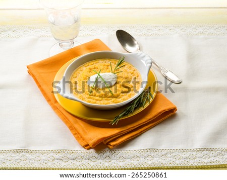 pumpkin soup with ricotta and chive - stock photo