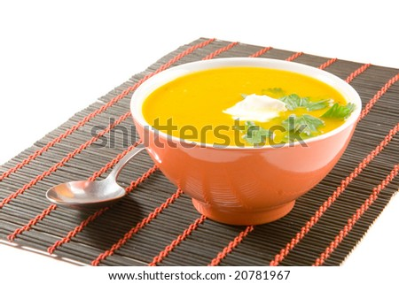 Pumpkin soup with spoon - stock photo