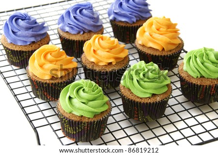 Pumpkin spice cupcakes in Halloween colors - stock photo