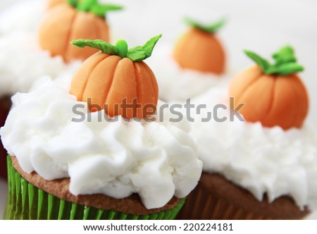 Pumpkin spice cupcakes with vanilla frosting. - stock photo