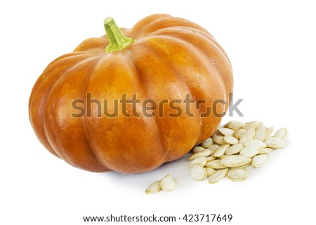 Pumpkin with a bright peel and seeds on white - stock photo