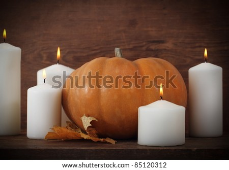 Pumpkin with candels on the wooden background - stock photo