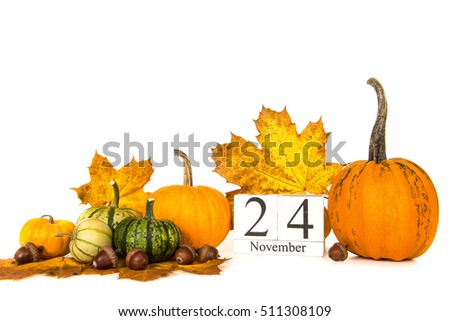 Pumpkins and autumn leaves with date 24 november, thanksgiving on a white background