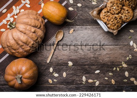 Pumpkins and cookies on wood in Rustic style. Autumn Season food photo - stock photo
