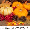 Pumpkins and Gourd with pine cones, leaves and candy corn, close up background - stock photo