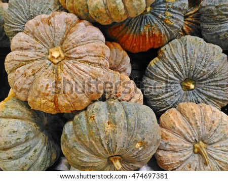 Pumpkins are for sale in a local market in Thailand