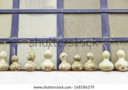 Pumpkins drying on the street detail of some vegetables for decoration - stock photo