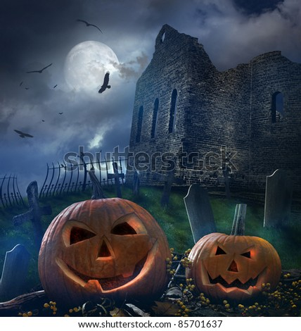 Pumpkins in graveyard with church ruins - stock photo
