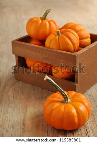 Pumpkins in the wooden box