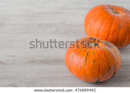 Pumpkins on the white table horizontal