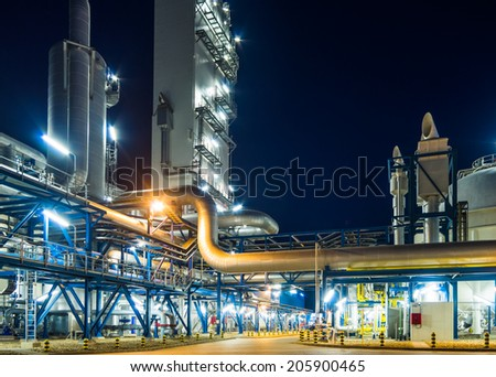 pumps and piping system at night - stock photo