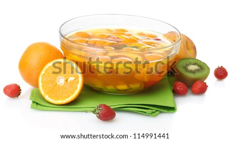 punch in glass bowl with fruits, isolated on white