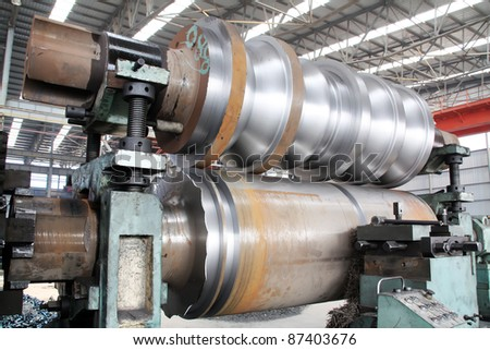 punch in the iron and steel enterprise production workshop in China - stock photo
